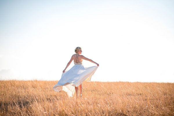 bride-in-field-of-wheat