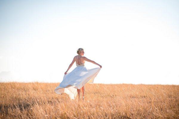 bride-in-field-of-wheat