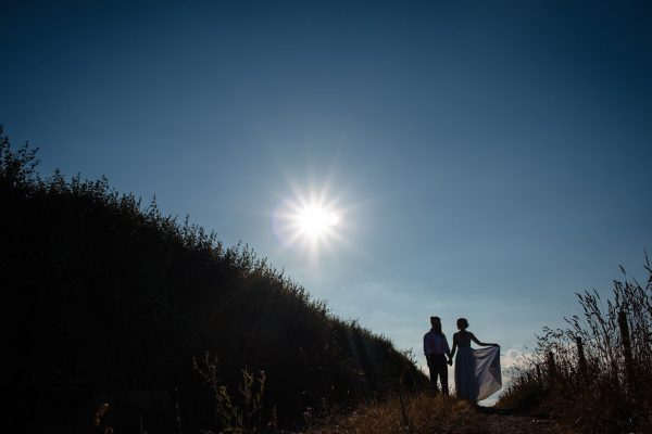 couple-in-sunny-field-of-wheat